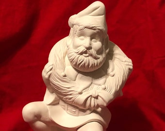 Ceramic Christmas Elf with a wreath in bisque ready to paint by jmdceramicsart