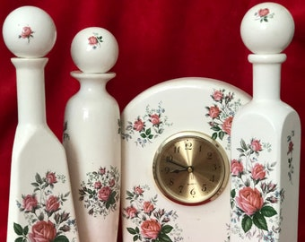 Vintage 7 piece set of Glazed with Decals Ceramic Clock and Vases with Tops