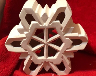 Clay Magic's Small Ceramic Snowflake with cut outs for light in bisque ready to paint