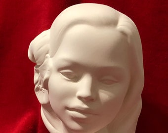 Bust of a Girl with flower in hair ceramic bisque  ready to paint