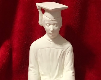 The Graduate in ceramic bisque ready to paint