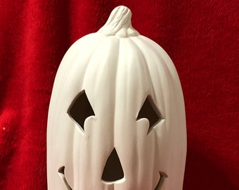 Small Slim Ceramic Pumpkin with cut outs for lights in bisque ready to paint