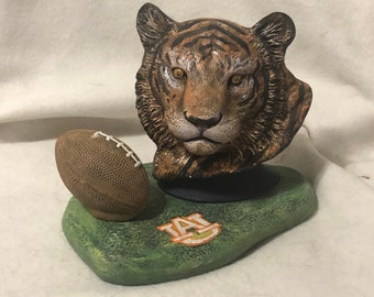 Auburn Tigers with football and base