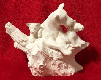 Driftwood Lioness and her cubs in ceramic bisque ready to paint