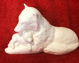 Wolf bathing her cub in ceramic bisque ready to paint