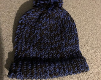 69772aff9da Hand knit winter poof ball hat Blue and Black beanie