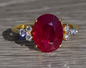 Ladies 18K Yellow Gold Ring set with 3.44 CT Oval Ruby and Diamonds