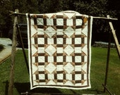 Brown churn-dash quilt