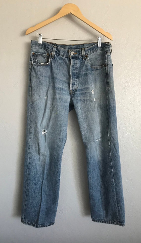 Vintage Levis 501 33x30 button fly distressed