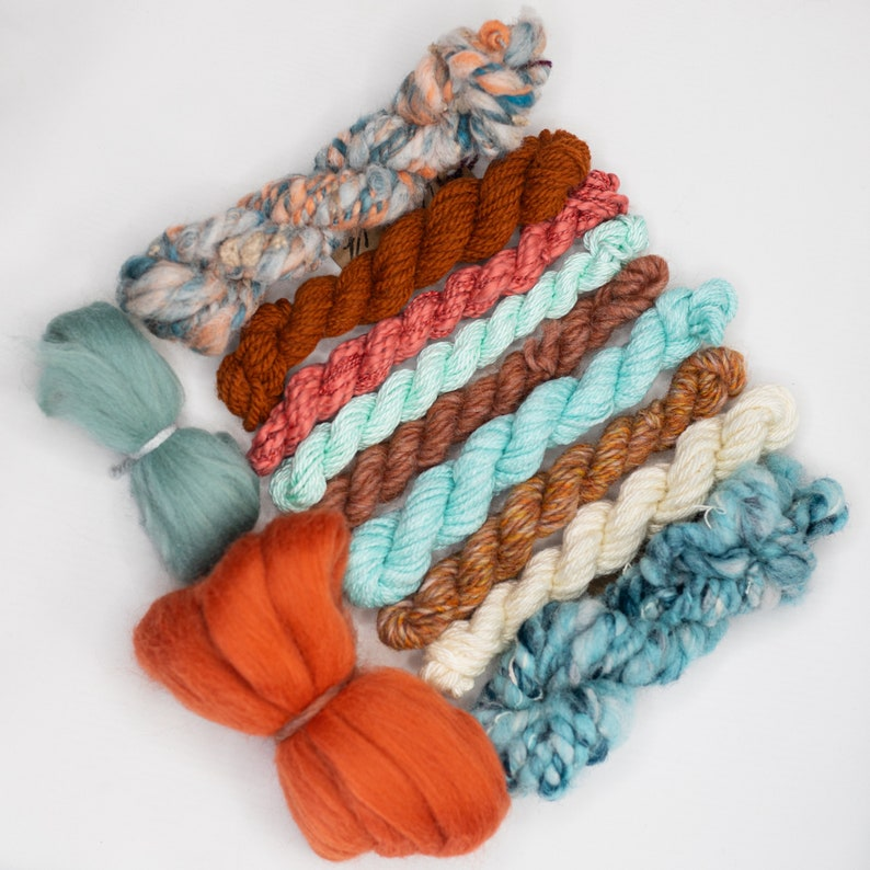 green and rust tone handspun art yarn bundle .Weaving textile fiber pack. Blue,teal