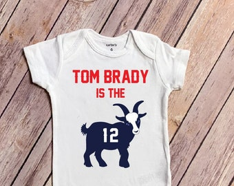 6f4348497 Tom Brady is the GOAT - Patriots Inspired Baby Bodysuit - Red and Navy  Patriots Inspired Colors