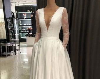 8e169a5773f Satin wedding dress Faen by Olivia Bottega. Long sleeve wedding dress.  Pockets on skirt. French Lace long sleeves. deep neckline.