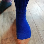 Pair of mismatched long ribbed topped socks