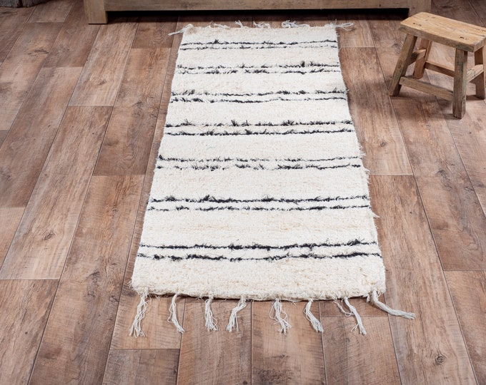 White carpet ecru black cotton strip recycled cotton eco-friendly contemporary interior for bed drop. 60cm 180cm