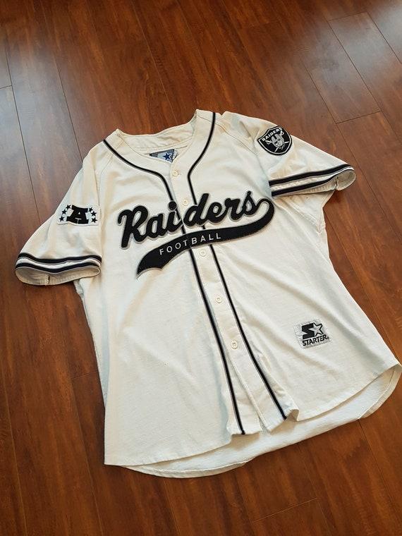 90s Raiders script. Iconic baseball jersey