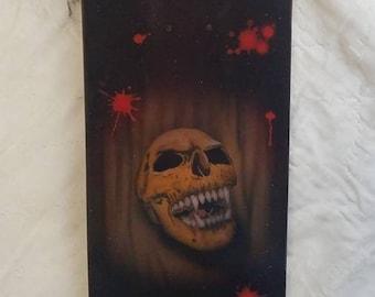 Vampire skull and blood