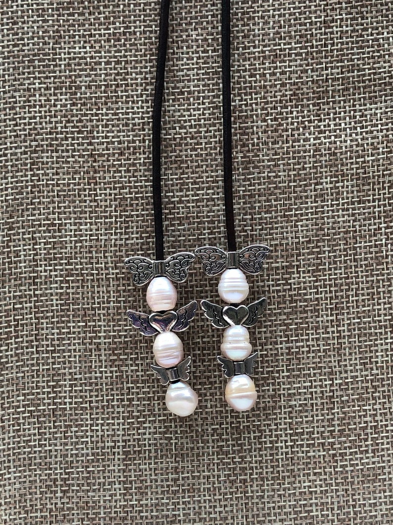 Leather and Freshwater Pearl Choker Y necklace.
