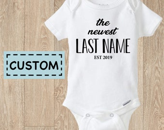 56d3b832a14 Customized THE NEWEST ( Your Name) Est 2019 Baby Onesie