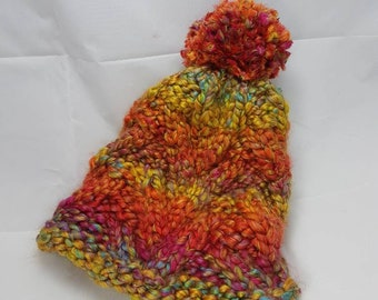 Multi-coloured V pattern pompom beanie. Winter hat very thick wool. cc42fd2ba44