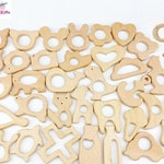 wooden teether, animal shapes and other