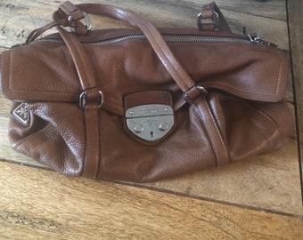 10d8ef1230c2 Vintage leather push lock prada bag