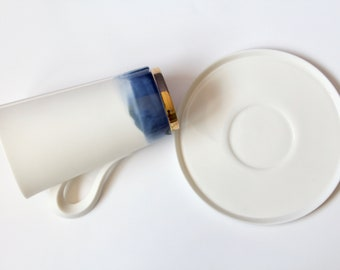 Large porcelain cup with gold footring