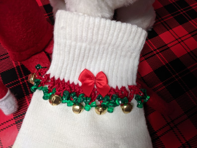 White with Red and Green trim. Fall Fixer Glove