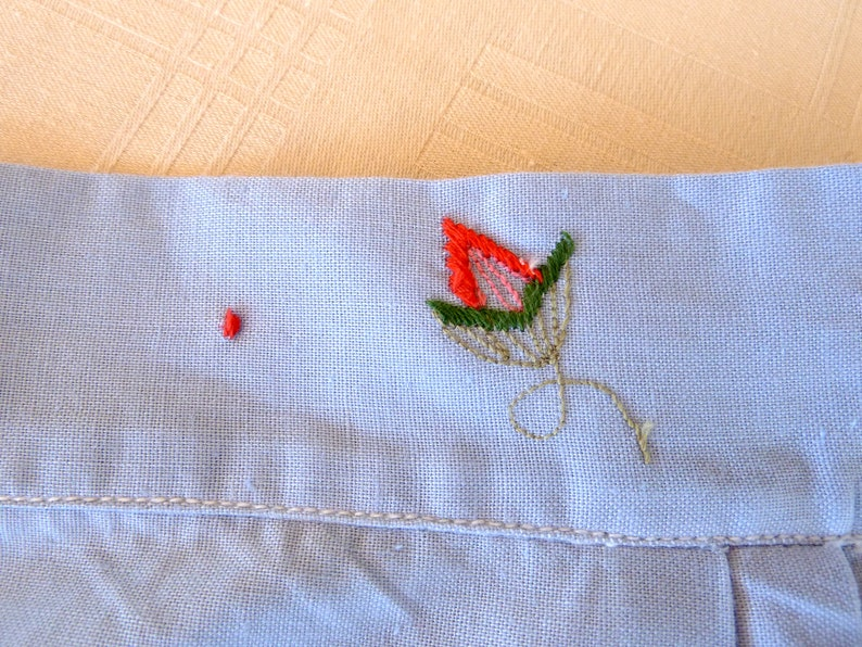 Vintage Embroidered light blue cotton apron with flowers and pocket