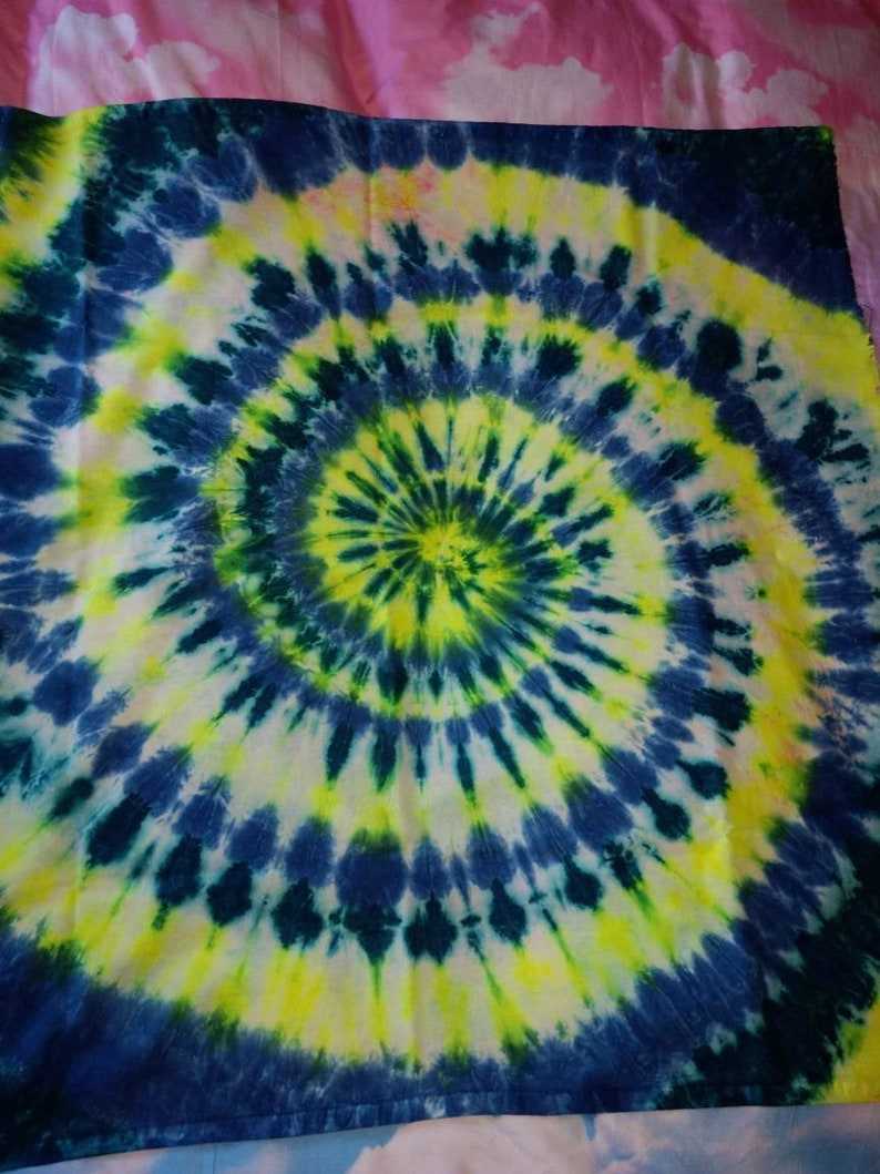 Tie dye wall hanging with a Neon yellow and blue spiral