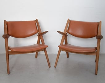 Pair of Oak Sawbuck armchairs by Hans J. Wegner for Carl Hansen and son