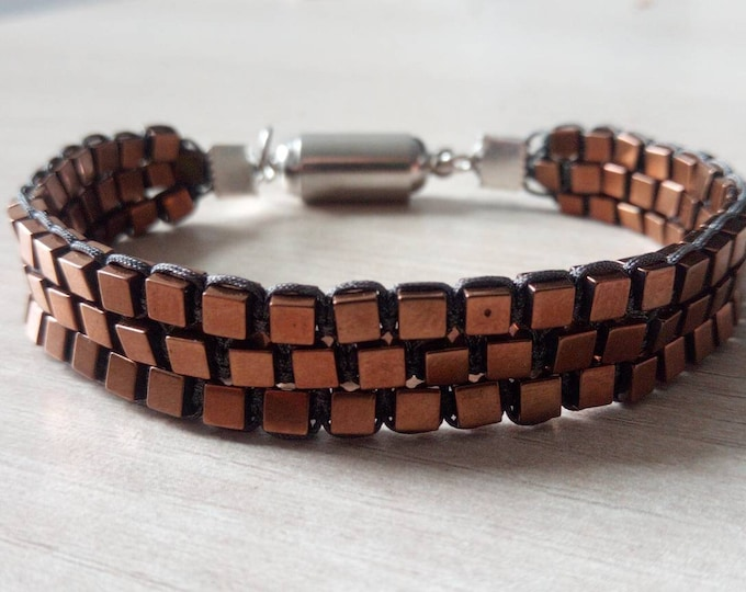 Tri-band cuff in copper hematite