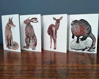 Pack of 4 linocut design wildlife greeting cards featuring a fox, deer, hare and otter.
