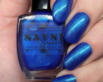 Blue Wave - Periwinkle blue nail polish with duochrome teal/turquoise shimmer