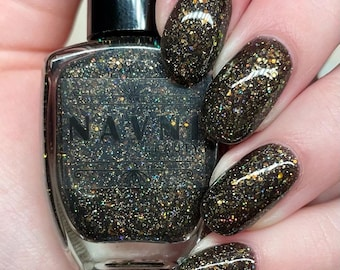 Out of the Darkness - black based glitter polish with holographic gold glitter and iridescent glitters