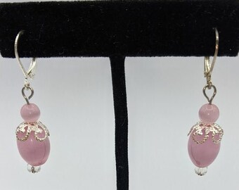 Pink glass beads w/ sterling silver accents add a shimmer to these leverback earrings.
