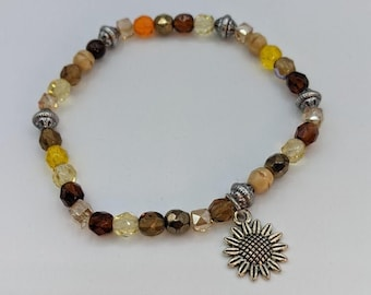 Charming bracelet w/ Glass beads and a pewter sunflower charm.