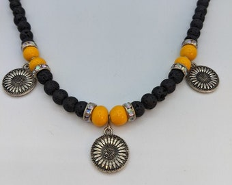 Black Volcanic beads and Yellow Ceramic beads with 3 pewter double sided sunflowers.