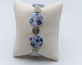 Blue floral circles with pewter pacer.