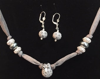 Beautiful hand crafted and painted beads with a gray silk ribbon necklace and silver earrings Set