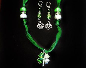 Great Gift for St. Patrick's Day.  Beautiful designed beads and soft green silk ribbon necklace and silver earrings Set