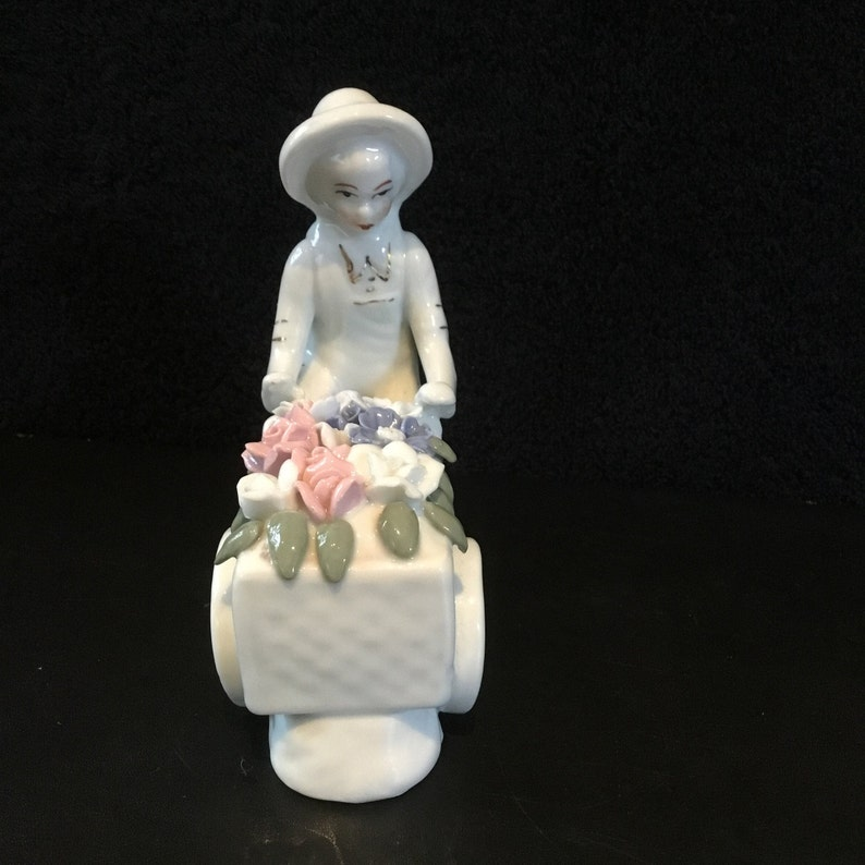 Rare Art Deco french figurine porcelain \u201cboy delivering flowers on a bicycle\u201d