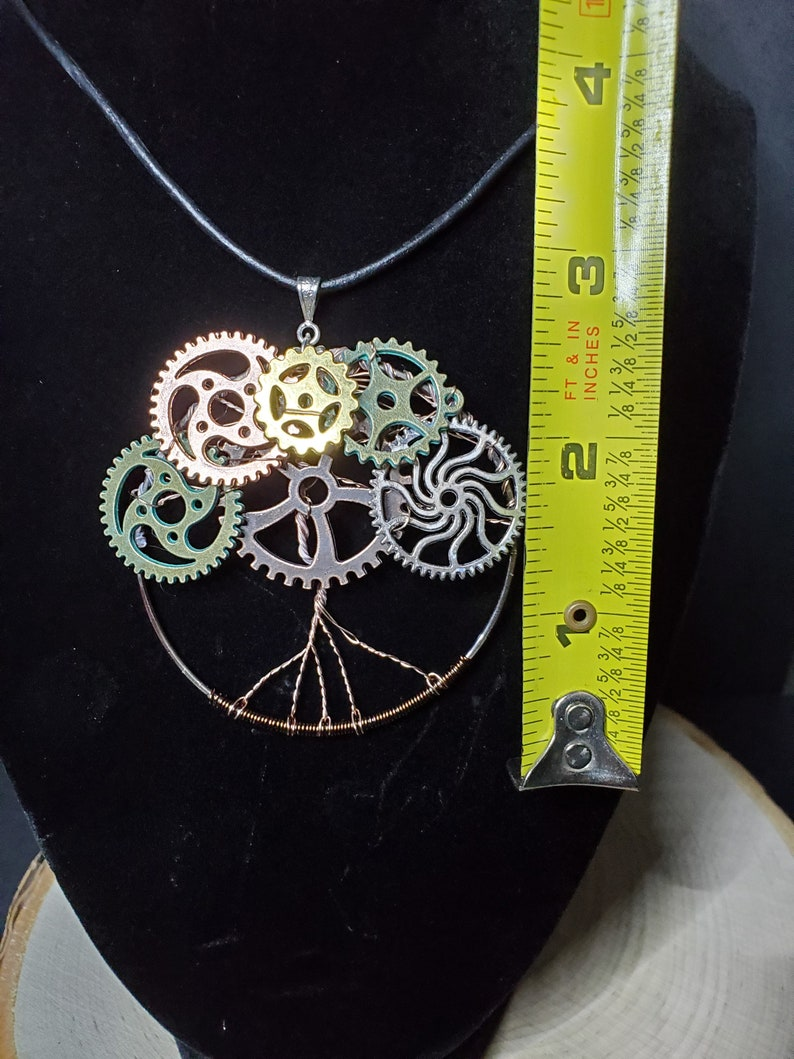 Pendant makes for a great statement piece pendant with cord style necklace Steampunk inspired tree of life handmade