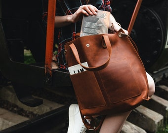Large cognac leather tote bag for women with outside pockets zipper and custom inside section for laptop
