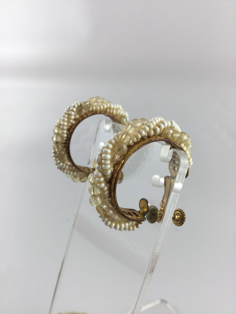Miriam Haskell not signed vintage bracelet and earrings .