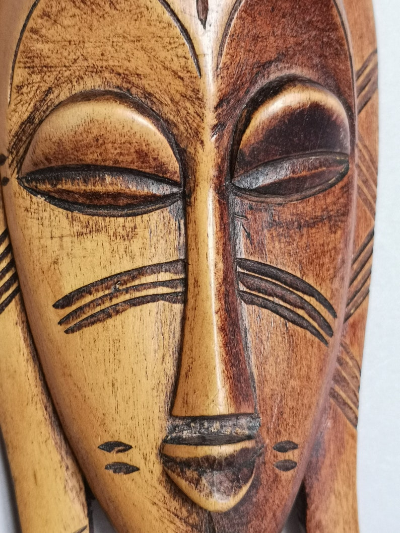 possibly from Ivory Coast Cote d/'Ivoire  and found in France A Lovely decorative Hand carved Small Tribal Passport type Mask