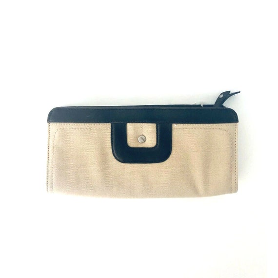 A soft buttery chocolate brown leatherette  foldover clutchwallet with snap closure tucked beneath for a clean sleek look. Liz  Claiborne