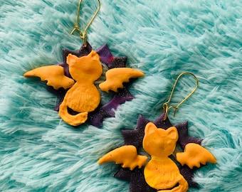 Yellow Orange  Cat with Wings on Purple Galaxy Sun Handmade Clay Earrings