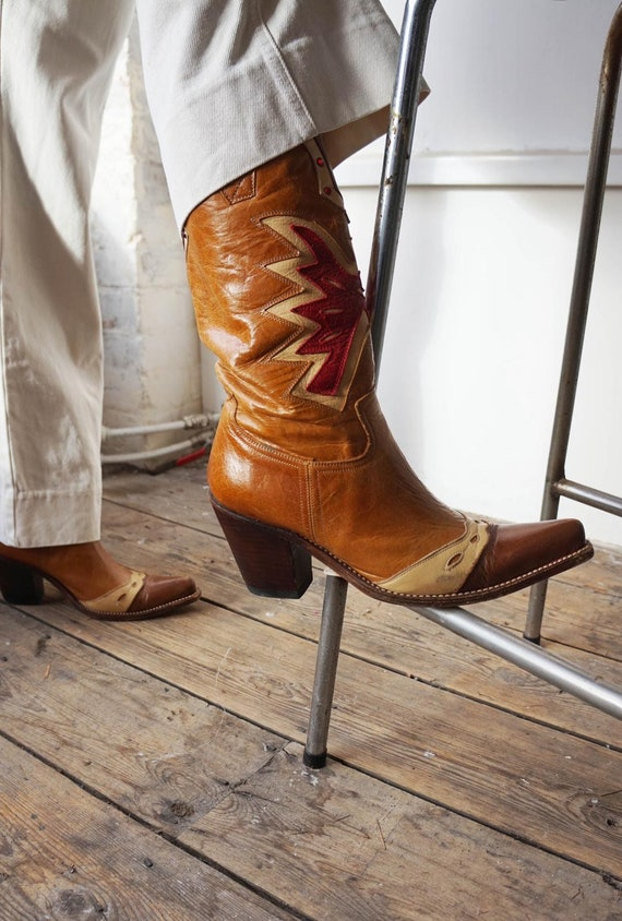 Vintage brown and red leather cowboy boots. Vintag