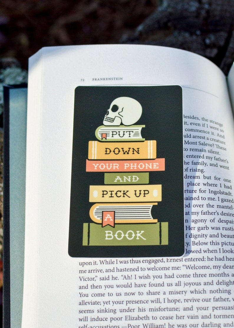 Pick Up A Book Vinyl Waterproof Sticker image 0