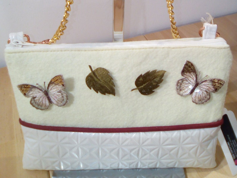Felt pouch butterfly leaves image 0